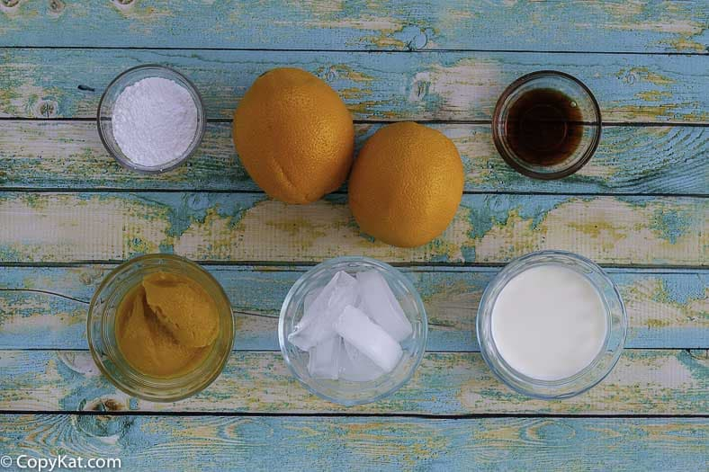 Ingredients for making an orange julius.