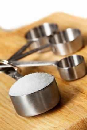 measuring sugar for a recipe