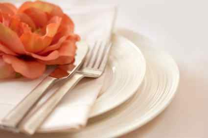 a white place setting for dinner
