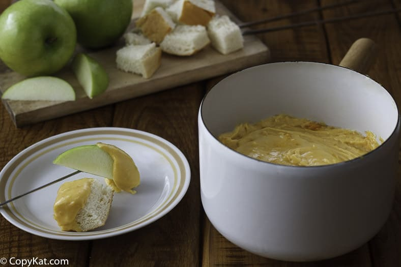 Melting pot cheddar cheese fondue served in a bowl.