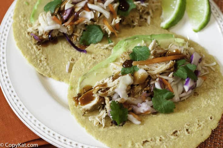 Pulled chicken tacos are delicious and easy to make in either your Instant Pot or a slow cooker.