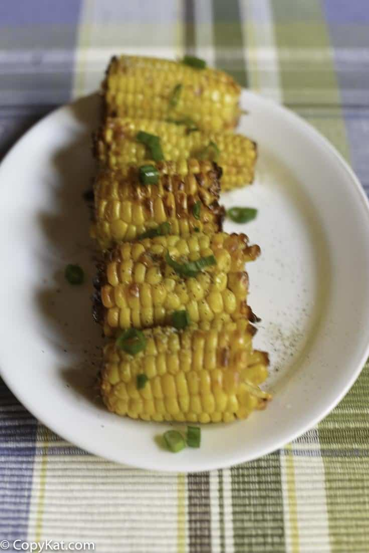 Make roasted corn in your air fryer.  It is easy to make perfectly roasted corn with your air fryer.