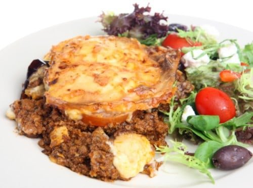 moussaka on a plate with greek salad