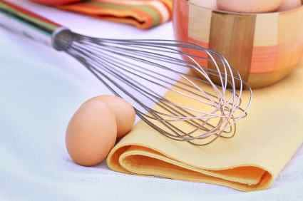 Egg Whisk and Brown Eggs
