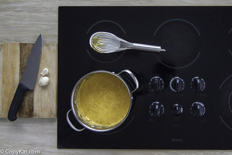 The Melting pot Cheddar cheese fondue can be made on the stove top.