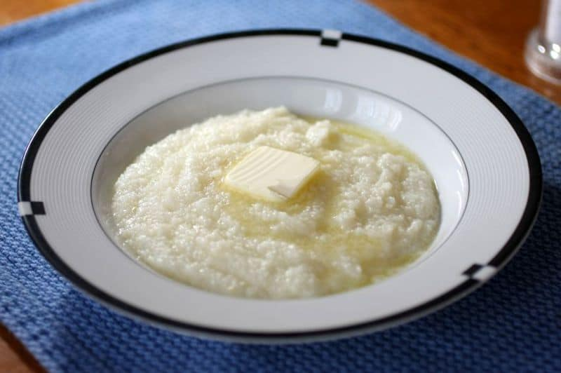 a bowl of grits with butter
