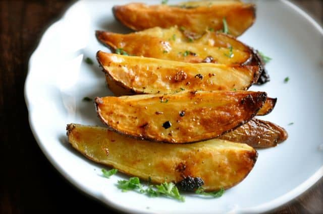 Roasted potatoes with lemon juice olive oil and oregano