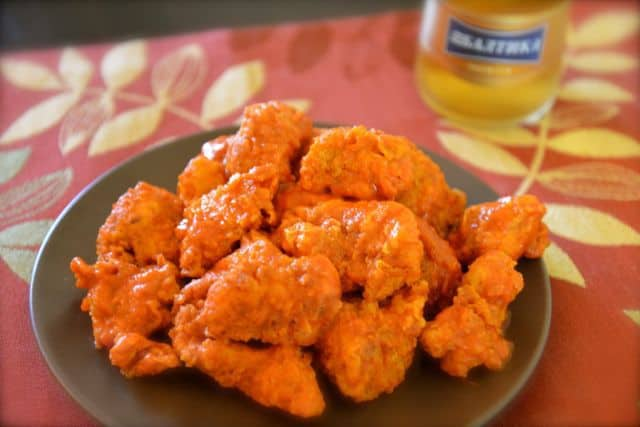 plate of boneless chicken bites with buffalo sauce