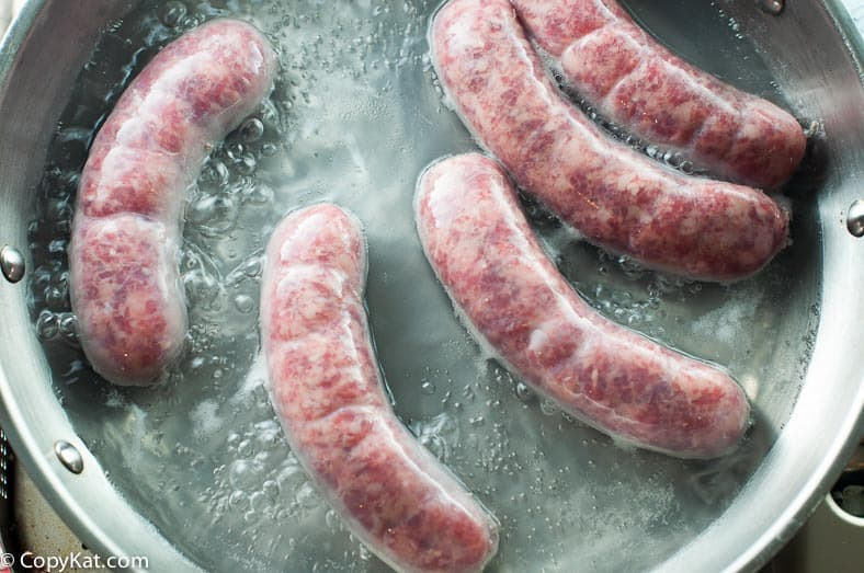 Cooking Johnsonville sausages for pretzel wrapped brats