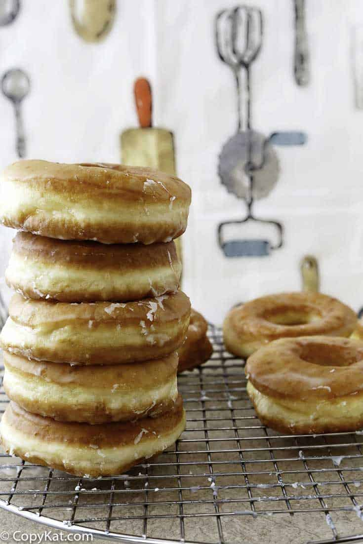 Make your own copycat Krispy Kreme Glazed Donuts at home with this copycat recipe.